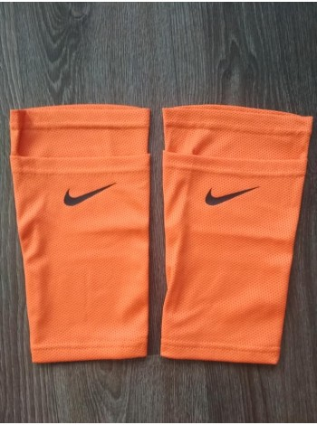 купить Фиксатор для футбольных щитков Nike оранжевый